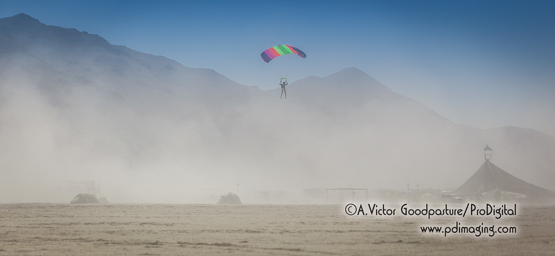 Parachutist lands near the airport during a dust storm.