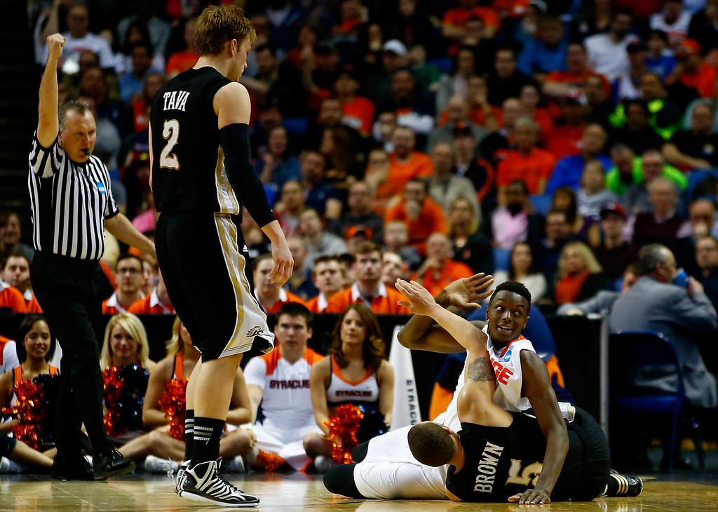 . BUFFALO, NY - MARCH 20: Jerami Grant #3 of the Syracuse Orange and David Brown #5 of the Western Michigan Broncos battle for a loose ball during the second round of the 2014 NCAA Men\'s Basketball Tournament at the First Niagara Center on March 20, 2014 in Buffalo, New York.  (Photo by Jared Wickerham/Getty Images)