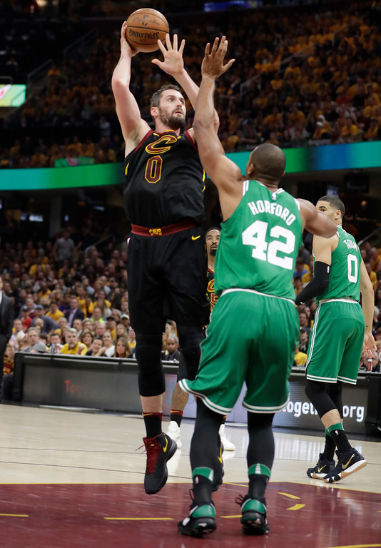 . Cleveland Cavaliers\' Kevin Love (0) shoots over Boston Celtics\' Al Horford (42), from Dominican Republic, in the first half of Game 3 of the NBA basketball Eastern Conference finals, Saturday, May 19, 2018, in Cleveland. (AP Photo/Tony Dejak)
