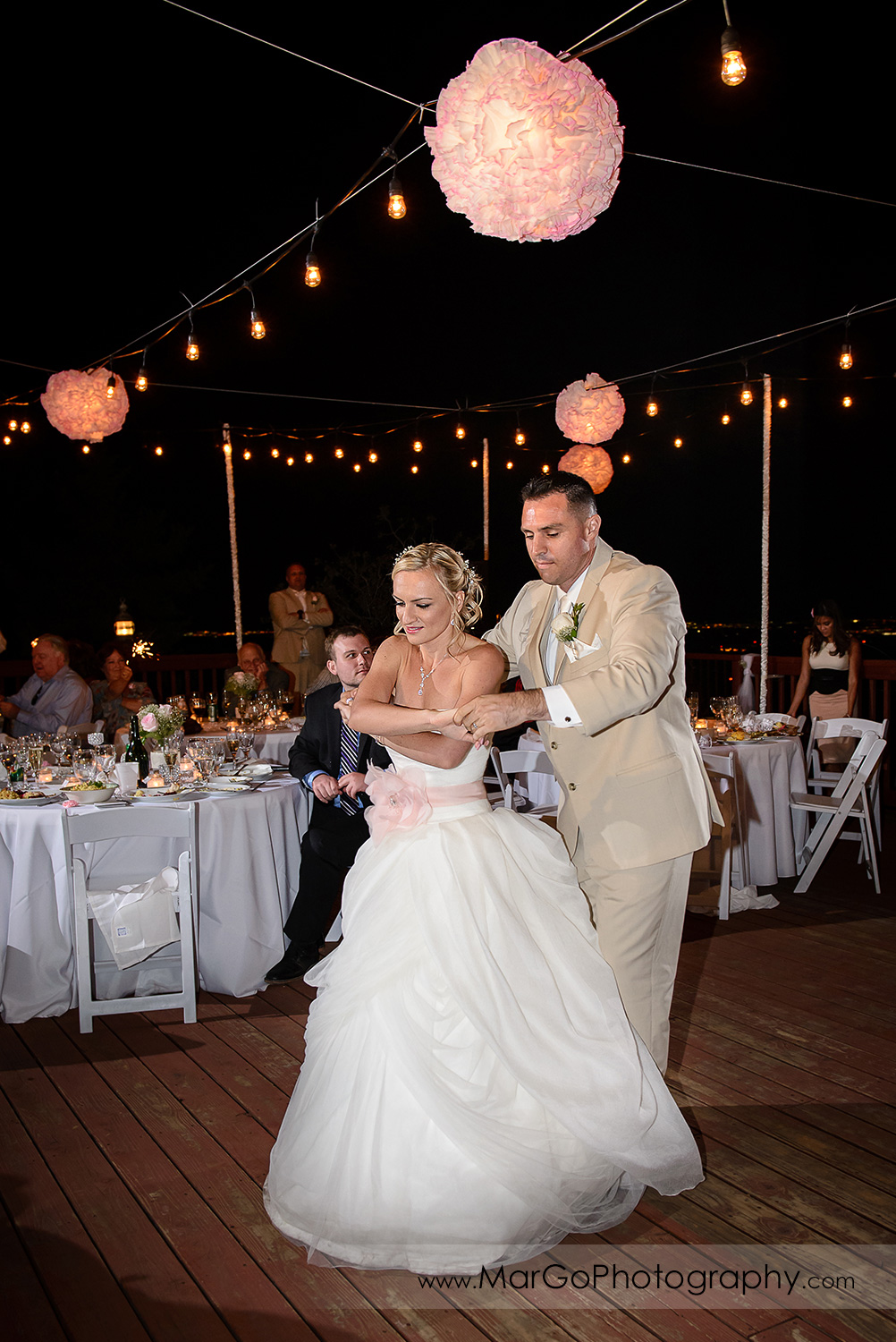 first dance of bride and groom during backyard wedding reception