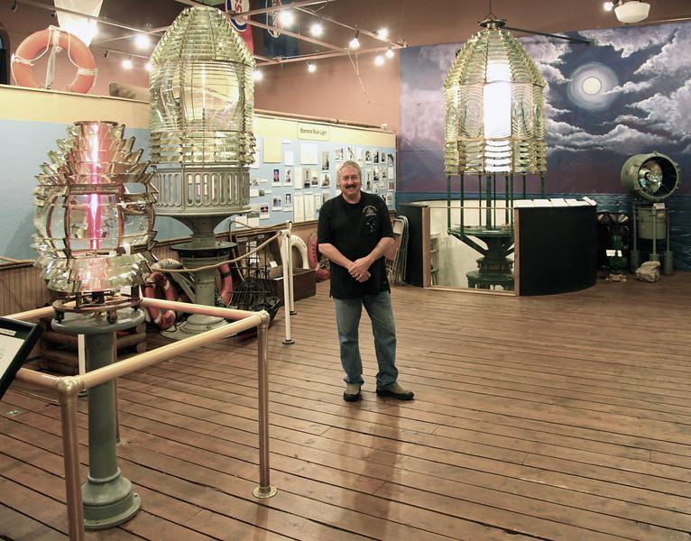 Kurt Fosburg and three of his restored lenses.