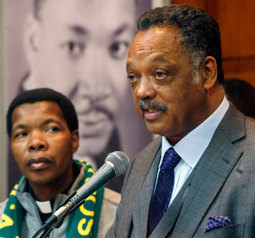 . Rev. Jesse Jackson Sr., right, and Catholic priest Thulani Magwaza, from South Africa, talk about the life of Nelson Mandela before a prayer vigil in honor of Mandela at the Rainbow Push Coalition headquarters Friday, Dec. 6, 2013, in Chicago. (AP Photo/Charles Rex Arbogast)