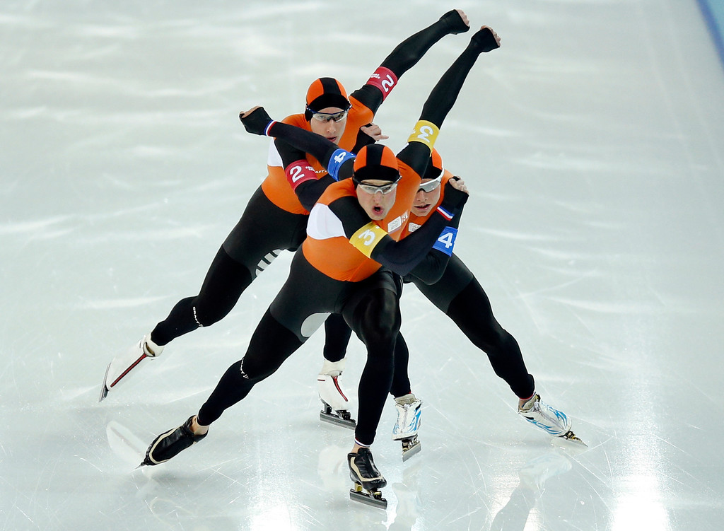 . Speedskaters from team Netherlands, from top to bottom, Jan Blokhuijsen, Koen Verweij and Sven Kramer compete in the men\'s speedskating team pursuit quarterfinals at the Adler Arena Skating Center during the 2014 Winter Olympics in Sochi, Russia, Friday, Feb. 21, 2014.  (AP Photo/Pavel Golovkin)