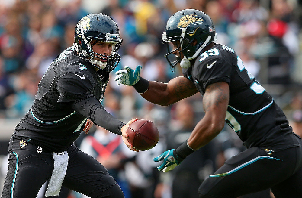 . Chad Henne #7  hands off to Richard Murphy #39 of the Jacksonville Jaguars during a game against the New England Patriots at EverBank Field on December 23, 2012 in Jacksonville, Florida.  (Photo by Mike Ehrmann/Getty Images)