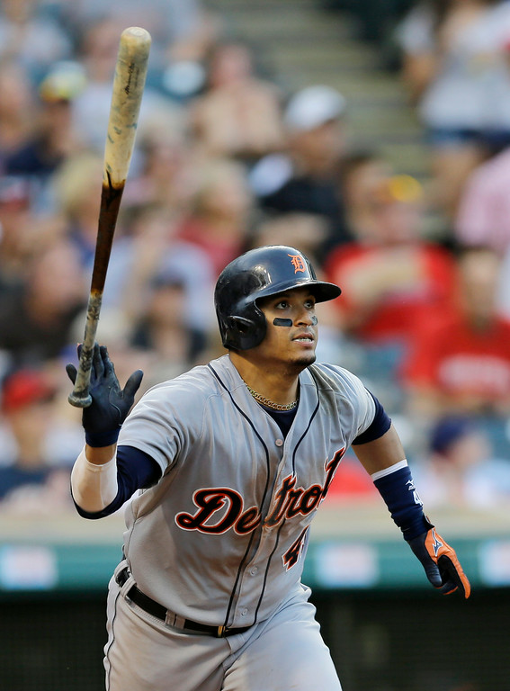 . Detroit Tigers\' Victor Martinez hits a double off Cleveland Indians starting pitcher Zach McAllister in the seventh inning of a baseball game, Monday, Sept. 1, 2014, in Cleveland. (AP Photo/Tony Dejak)