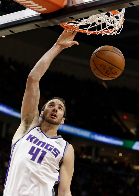 . Sacramento Kings\' Kosta Koufos dunks the ball in the second half of an NBA basketball game against the Cleveland Cavaliers, Wednesday, Dec. 6, 2017, in Cleveland. (AP Photo/Tony Dejak)