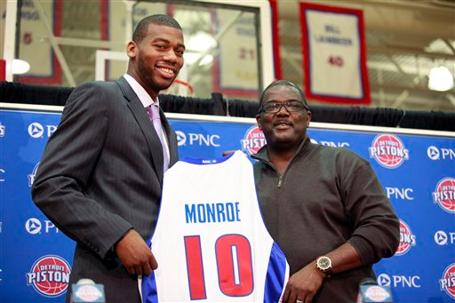 . Joe Dumars, Detroit Pistons president of basketball operations, right, stands with draft pick Greg Monroe during a news conference, Saturday, June 26, 2010, in Auburn Hills, Mich. Monroe, a 6-foot-11 forward from Georgetown, was the No. 7 pick. (AP Photo/Al Goldis)