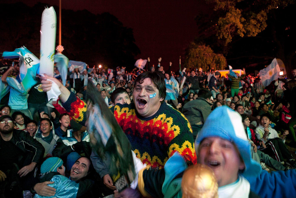 . Argentina soccer fans celebrate a goal against Bosnia while watching on an outdoor screen their team\'s Brazil World Cup game, in Buenos Aires, Argentina, Sunday, June 15, 2014. (AP Photo/Eduardo Di Baia)