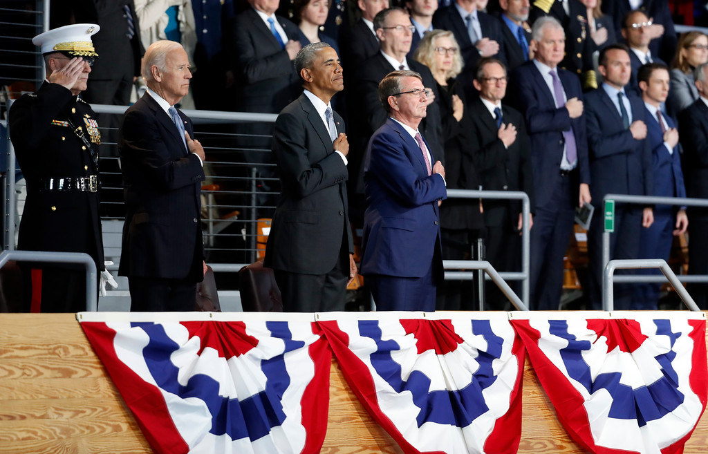 . President Barack Obama, Vice President Joe Biden, Defense Secretary Ash Carter, and Joint Chiefs Chairman Gen. Joseph Dunford, stand during the playing of the national anthem during an Armed Forces Full Honor Farewell Review for the president, Wednesday, Jan. 4, 2017, at Conmy Hall, Joint Base Myer-Henderson Hall, Va. (AP Photo/Alex Brandon)