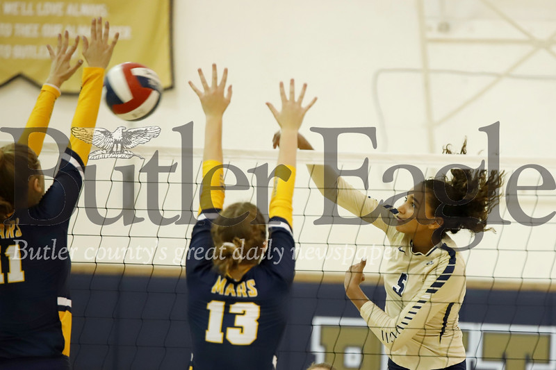 Ava Carney of Butler hits around a Mars block during the Golden Tornado's 3-1 home win Monday night. Seb Foltz/Butler Eagle