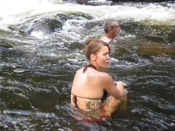 Paige cavorting in the river.