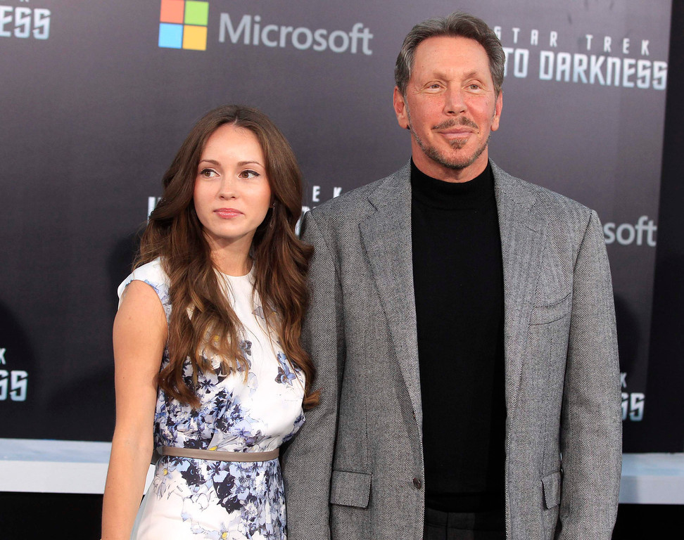 """. Oracle CEO Larry Ellison and Nikita Kahn arrive as guests for the premiere of the new film \""""Star Trek Into Darkness\"""" in Hollywood May 14, 2013. Ellison\'s son David is the executive producer of the film. REUTERS/Fred Prouser"""