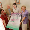 Gervase McCarten, of Cancer Research Northern Ireland, accepts a cheque on behalf of the management and staff of Newry and Mourne Women Ltd and affiliated Women's groups, Kathleen Smith, Duana Rooney and Liz Greene. The money was raised through sponsorship in support of Cancer Research Fun Day in June 06. 06W35N1