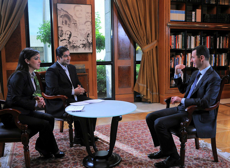 . Syria\'s President Bashar al-Assad (R) attends an interview with Syrian television channel al-Ikhbariya in Damascus, in this handout photograph distributed by Syria\'s national news agency SANA on April 17, 2013. Assad said Western nations will suffer the consequences for what he said was their support for al Qaeda militants in Syria\'s civil war. REUTERS/SANA/Handout