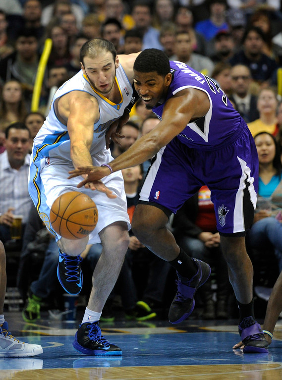 . DENVER, CO. - MARCH 22: Kosta Koufos (41) of the Denver Nuggets competed for a loose ball with Cole Aldrich (45) of the Sacramento Kings in the second half. The Denver Nuggets defeated the Sacramento Kings 101-95 Saturday night, March 23, 2013 at the Pepsi Center. The Nuggets extended its longest winning streak since joining the NBA to 15 games with the win over the Kings. (Photo By Karl Gehring/The Denver Post)