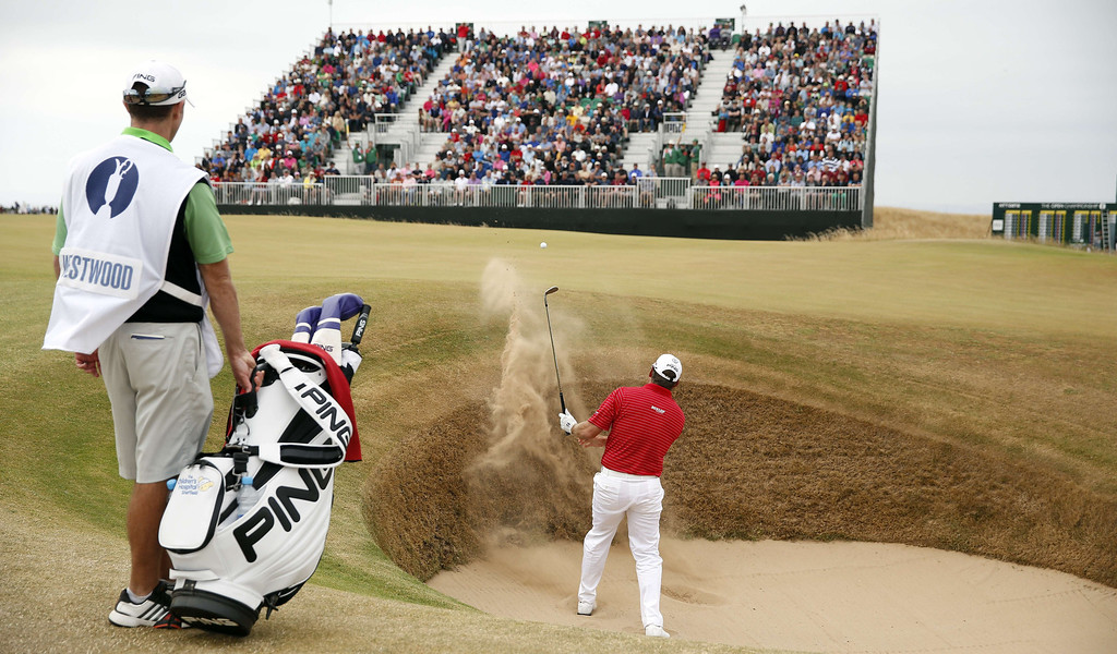 . England\'s Lee Westwood plays his first shot out of a bunker on the first during the fourth and final round of the 2013 British Open Golf Championship at Muirfield golf course at Gullane in Scotland on July 21, 2013.    ADRIAN DENNIS/AFP/Getty Images
