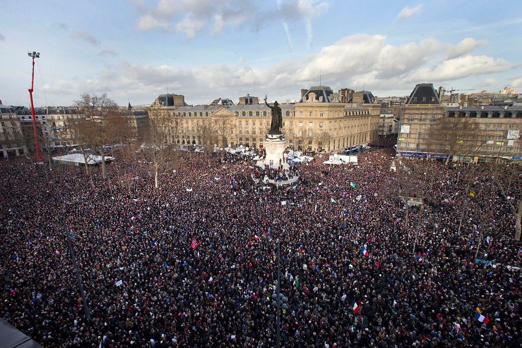 . Thousands of people gather at Republique square in Paris, France, Sunday, Jan. 11, 2015.  Thousands of people began filling France�s iconic Republique plaza, and world leaders converged on Paris in a rally of defiance and sorrow on Sunday to honor the 17 victims of three days of bloodshed that left France on alert for more violence. (AP Photo/Peter Dejong)