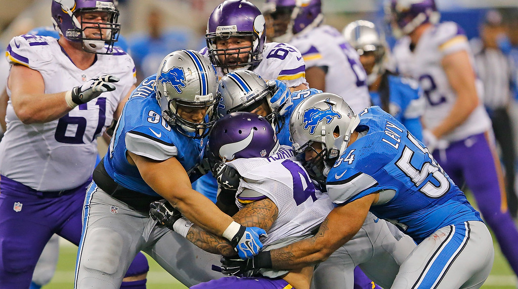 . DETROIT, MI - DECEMBER 14: Matt Asiata #44 of the Minnesota Vikings is stopped by Ndamukong Suh #90 and DeAndre Levy #54 of the Detroit Lions during the third quarter of the game at Ford Field on December 14, 2014 in Detroit, Michigan. The Lions defeated the Vikings 16-14. (Photo by Leon Halip/Getty Images)