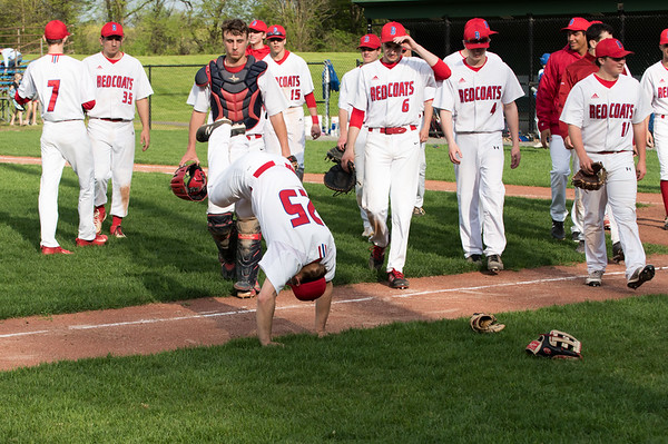 05/6/19 Wesley Bunnell | Staff Berlin baseball defeated Bristol Eastern at Sage Park on Tuesday afternoon. Dan Veleas (25) does a flip in front of his teammates as they walk back to the dugout at the end of shaking hands with Bristol Eastern.