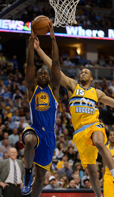 . DENVER, CO. - APRIL 23: Golden State Warriors small forward Harrison Barnes (40) dunks the ball against Denver Nuggets power forward Anthony Randolph (15) in the third quarter. The Denver Nuggets took on the Golden State Warriors in Game 2 of the Western Conference First Round Series at the Pepsi Center in Denver, Colo. on April 23, 2013. (Photo by John Leyba/The Denver Post)