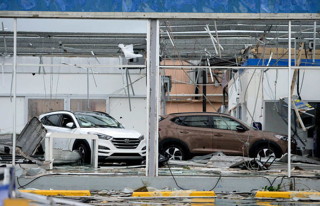 . A car dealership lays in disarray after the impact of Hurricane Maria, which hit the eastern region of the island, in Humacao, Puerto Rico, Wednesday, Sept. 20, 2017. (AP Photo/Carlos Giusti)
