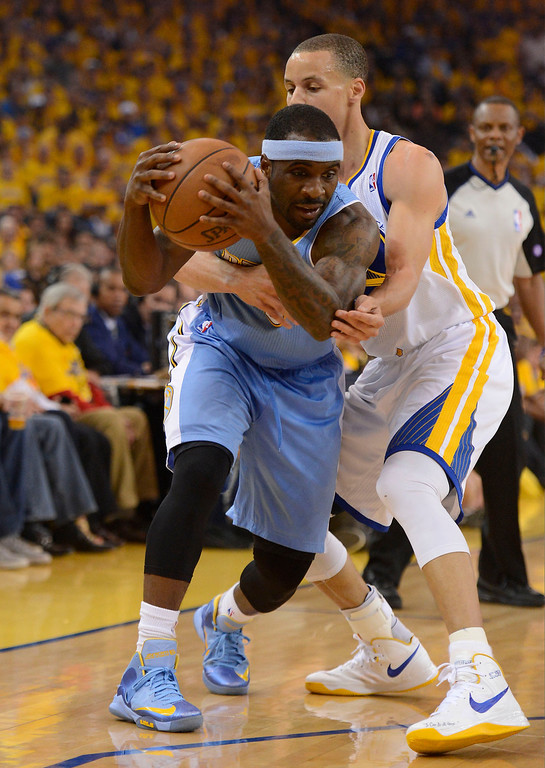 . Stephen Curry (30) of the Golden State Warriors reaches in on Ty Lawson (3) of the Denver Nuggets during the first quarter in Game 6 of the first round NBA Playoffs May 2, 2013 at Oracle Arena. (Photo By John Leyba/The Denver Post)