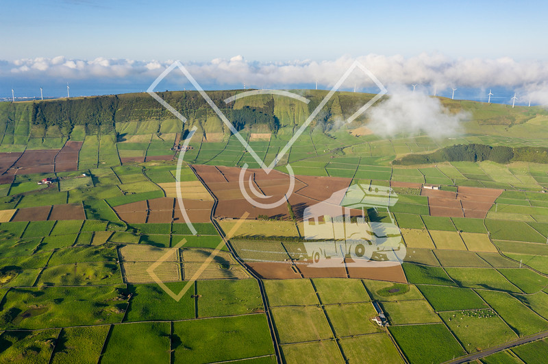 aerial views on the typical abstract countryside of the east of Terceira Island, one of the islands of the Açores (Azores) archipelago. Serra da Ribeirinha and The Miradouro da Serra do Cume offer great views on these abstract dairy cattle farming fields with stone walls