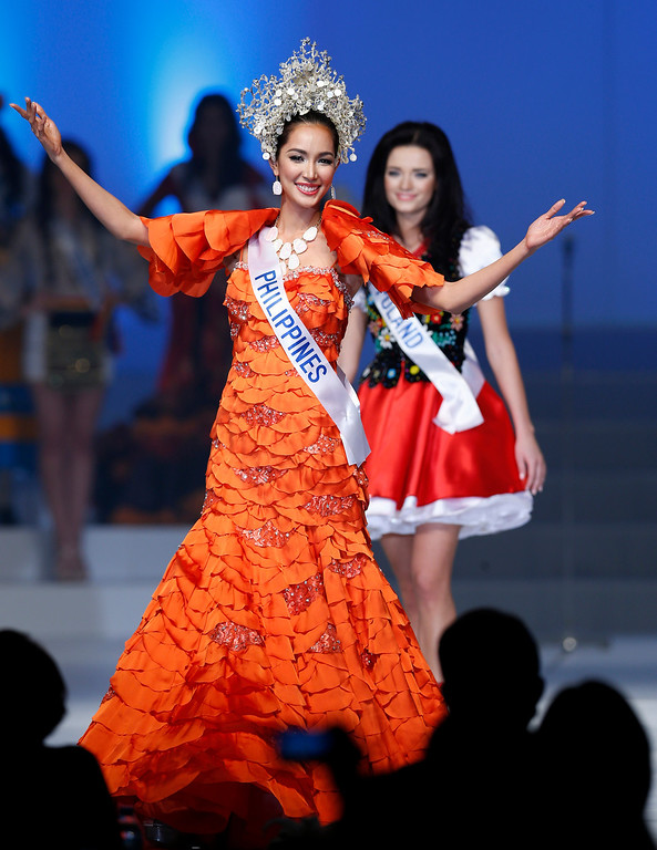 . Miss Philippines Bea Rose Santiago walks with a traditional dress during the final of the 53rd Miss International Beauty Pageant in Tokyo, Tuesday, Dec. 17, 2013. Santiago won this year\'s Miss International pageant. (AP Photo/Shizuo Kambayashi)