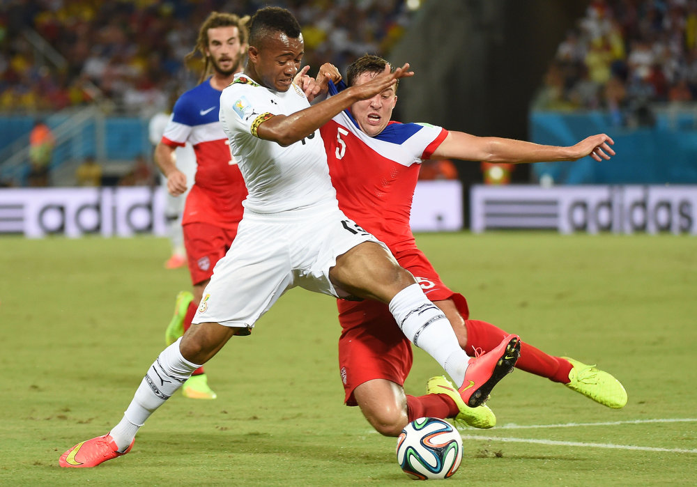 Description of . Ghana's forward Jordan Ayew (L) vies with US defender Matt Besler (R) during a Group G football match between Ghana and US at the Dunas Arena in Natal during the 2014 FIFA World Cup on June 16, 2014.    EMMANUEL DUNAND/AFP/Getty Images