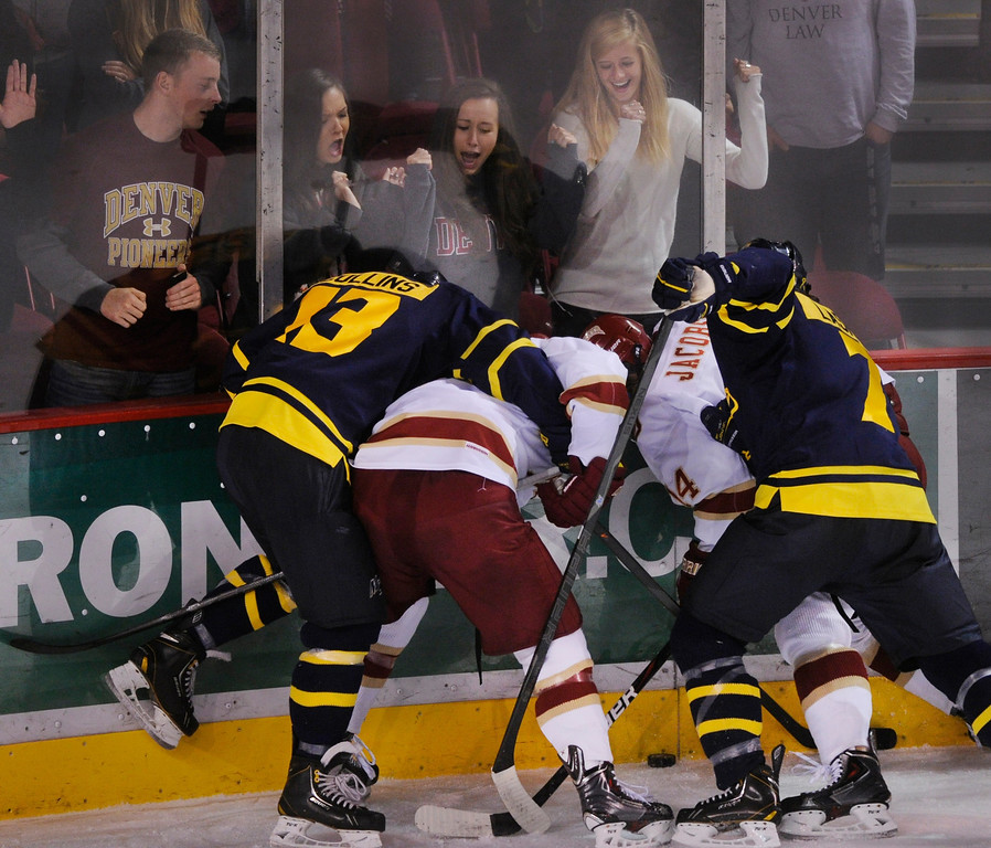 . DENVER, CO. - OCTOBER 12: Denver students pounded on the glass with the action right in front of them in the first period. The University of Denver hockey team hosted Merrimack at Magness Arena, Saturday night, October 12, 2013. Photo By Karl Gehring/The Denver Post