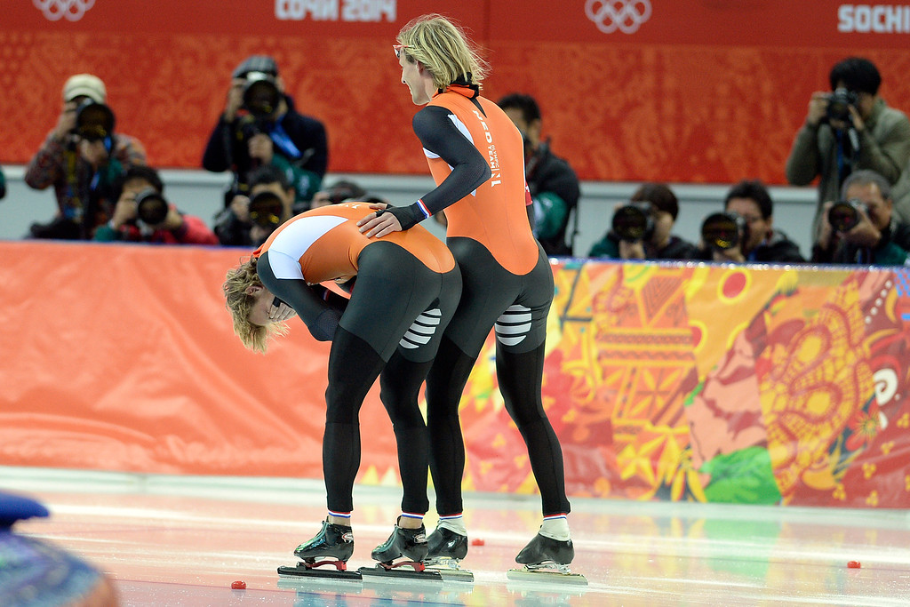 . Michel Mulder of the Netherlands reacts to capturing gold as his brother Ronald, who won bronze, rubs his back during the speed skating men\'s 500-meter at Adler Arena. Sochi 2014 Winter Olympics on Monday, February 10, 2014. (Photo by AAron Ontiveroz/The Denver Post)