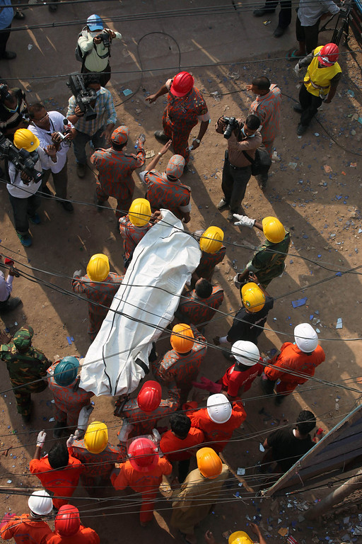 . In this photograph taken  on April 29, 2013, Bangladeshi firefighters carry the body of garment worker Shahina Akter following her unsuccessful rescue from the eight-story building that collapsed in Savar, on the outskirts of Dhaka.  Bangladesh widow Shahina Akter\'s vain 100-hour struggle to survive the collapse last week of a garment factory has made her the tragic face of the nation\'s worst industrial disaster. AFP PHOTO/STR/FILESSTRDEL/AFP/Getty Images