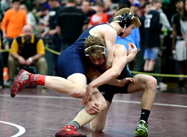 2/16/2019 Mike Orazzi | Staff Bristol Eastern's Justin Marshall and RHAM's Ryan Maleryn during the CIAC state open wrestling tournament at Bristol Central High School in Bristol Saturday.