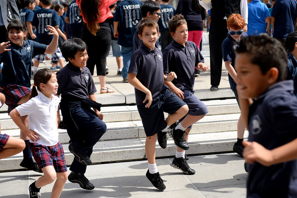 . Students from St. Robert Bellarmine Elementary School in Burbank joined more than 3,100 fifth grade students from throughout Los Angeles County as performed a choreographed dance on the Music Center Plaza on Wednesday, April 9, 2014, as part of the 44th Annual Blue Ribbon Children�s Festival. Students attended a performance by the Paul Taylor Dance Company at The Music Center, then gather on the plaza to perform a routine choreographed just for them. (Photo by Michael Owen Baker/L.A. Daily News)