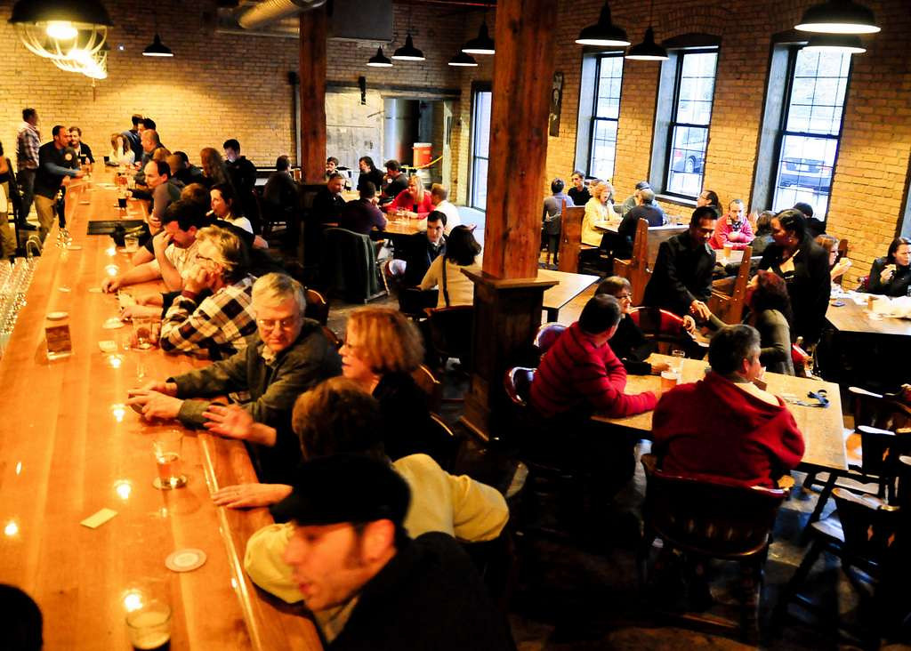 . Indeed Brewing in Minneapolis: The natural wood, exposed brick walls and big, old warehouse windows make for a scenic setting to throw one back. (Pioneer Press: Ben Garvin)