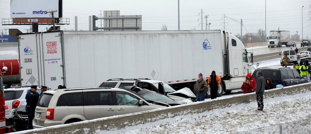 Description of . Traffic is at a stand still as emergency personnel responds to a multi-vehicle accident on Interstate 75  in Detroit, Thursday, Jan. 31, 2013. Snow squalls and slippery roads led to a series of accidents that left at least three people dead and 20 injured on a mile-long stretch of southbound I-75. More than two dozen vehicles, including tractor-trailers, were involved in the pileups. (AP Photo/The Detroit News, David Coates)