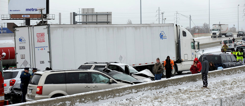 . Traffic is at a stand still as emergency personnel responds to a multi-vehicle accident on Interstate 75  in Detroit, Thursday, Jan. 31, 2013. Snow squalls and slippery roads led to a series of accidents that left at least three people dead and 20 injured on a mile-long stretch of southbound I-75. More than two dozen vehicles, including tractor-trailers, were involved in the pileups. (AP Photo/The Detroit News, David Coates)