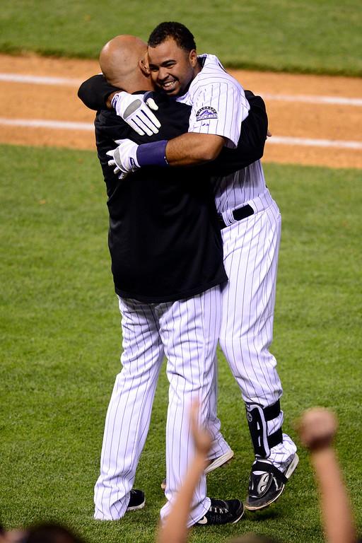 . DENVER, CO - MAY 21: Wilin Rosario (20) of the Colorado Rockies celebrates his walk-off single with hitting coach Dante Bichette during the Rockies\' 5-4 win at Coors Field. The Arizona Diamondbacks visited the Colorado Rockies. (Photo by AAron Ontiveroz/The Denver Post)
