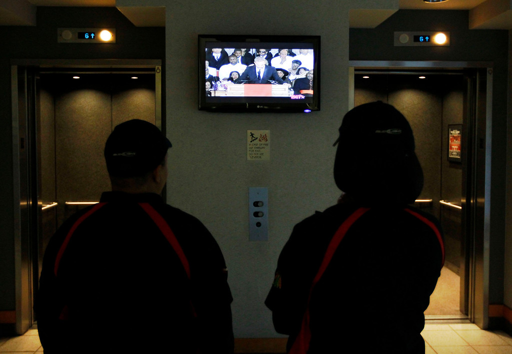 . Concession workers at the United Center, watch actor Kevin Costner eulogize Whitney Houston before an NBA basketball game between the Chicago Bulls and the New Jersey Nets, Saturday, Feb. 18, 2012, in Chicago. Houston died last Saturday at the Beverly Hills Hilton in Beverly Hills, Calif., at the age 48.  (AP Photo/Charles Rex Arbogast)