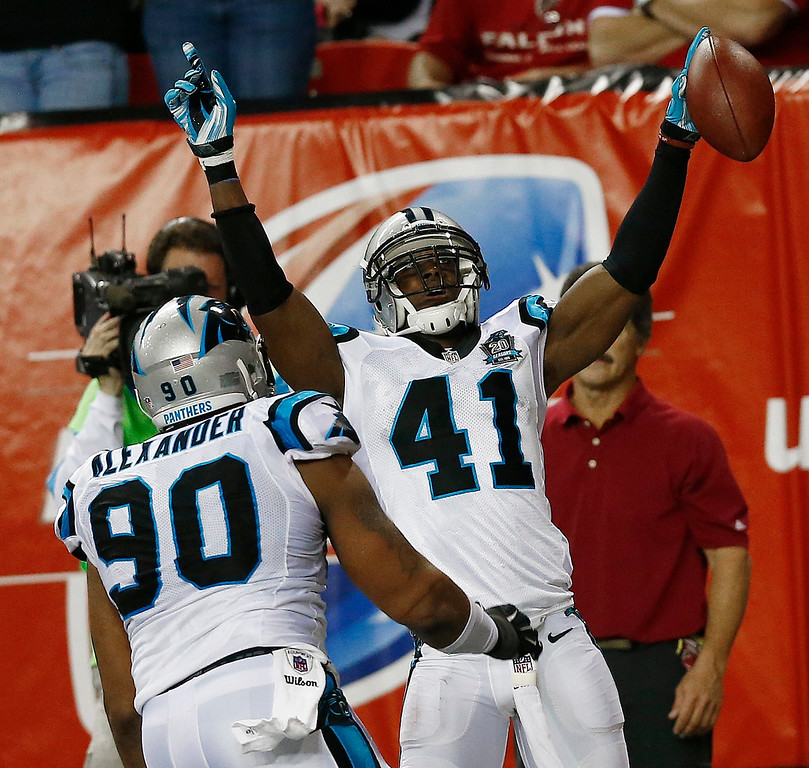 . Carolina Panthers strong safety Roman Harper (41) celebrates his touchdown after intercepting a Atlanta Falcons quarterback Matt Ryan ball during the first half of an NFL football game, Sunday, Dec. 28, 2014, in Atlanta. (AP Photo/John Bazemore)