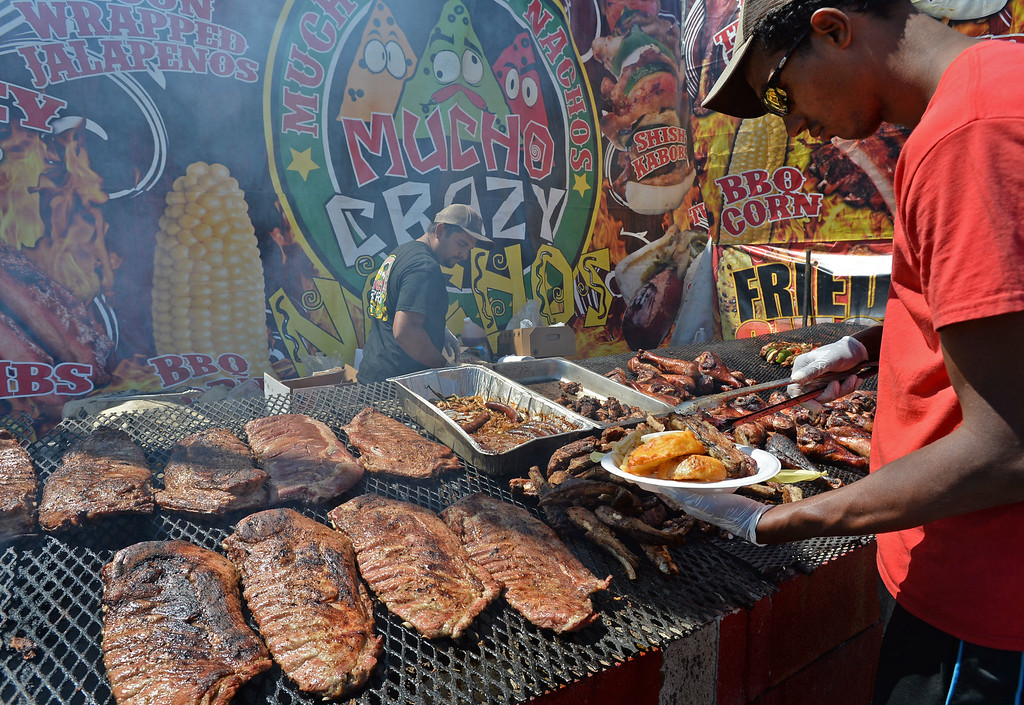 . Food of all types, such as bbq, are served Toyota Grand Prix of Long Beach Friday, April 17, 2015, Long Beach, CA.   Photo by Steve McCrank/Staff Photographer