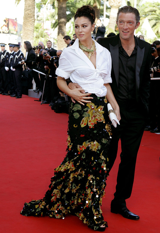 ". Italian actress Monica Bellucci and her husband French actor Vincent Cassel arrive for the screening of the film ""Indigenes\"" at the 59th International film festival in Cannes, southern France, Thursday, May 25, 2006.  (AP Photo/Kirsty Wigglesworth)"