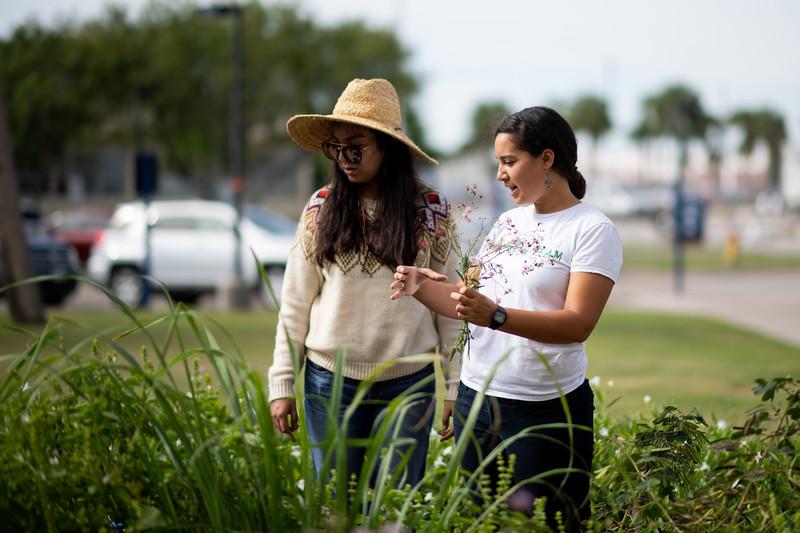Sofia Gonzalez (left), Melissa Zamora work on the Early Childhood and Development Center's community garden.