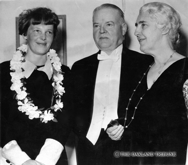. Oakland, CA January 19, 1935 - Former President Herbert and Mrs. Lou Hoover with Amelia Earhart Putnam photographed upon the noted woman flier\'s arrival at the Athens Athletic Club to attend the national testimonial banquet. (Oakland Tribune Staff Archives)