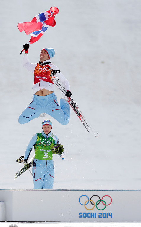. Norway\'s Magnus Hovdal Moan, front, and  Haavard Klemetsen celebrate winning the gold after the cross-country portion of the Nordic combined Gundersen large hill team competition at the 2014 Winter Olympics, Thursday, Feb. 20, 2014, in Krasnaya Polyana, Russia. (AP Photo/Matthias Schrader)