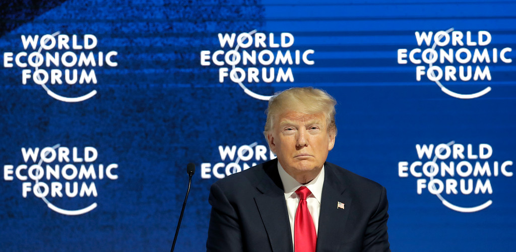 . U.S. President Donald Trump attends the speech of the founder of the forum, Klaus Schwab, during the annual meeting of the World Economic Forum in Davos, Switzerland, Friday, Jan. 26, 2018. (AP Photo/Markus Schreiber)