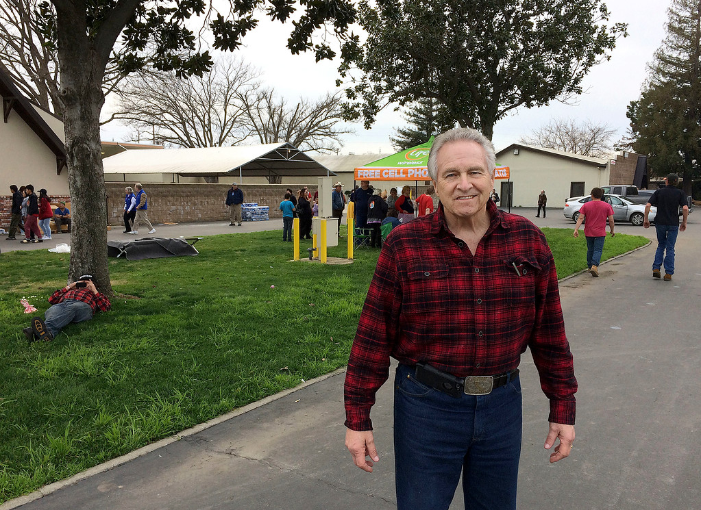 . State Sen. Jim Nielsen, R-Gerber, poses for photos at an evacuation center in Chico, Calif., Monday, Feb. 13, 2017. Nearly 200,000 people who were ordered to leave their homes out of fear that a spillway could collapse may not be able to return until the barrier at the Oroville Dam is repaired, a sheriff said Monday. (AP Photo/Don Thompson)