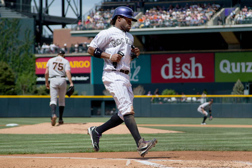 . Eric Young Jr. #1 of the Colorado Rockies walks in to score after Barry Zito #75 of the San Francisco Giants gave up a hit to Carlos Gonzalez #5 (not pictured) during the first inning at Coors Field on May 19, 2013 in Denver, Colorado.  (Photo by Justin Edmonds/Getty Images)