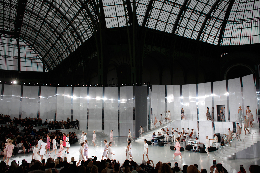 . Models present creations as part of the Chanel Spring-Summer 2014 Haute Couture fashion collection, presented Tuesday, Jan. 21, 2014 in Paris. (AP Photo/Thibault Camus)