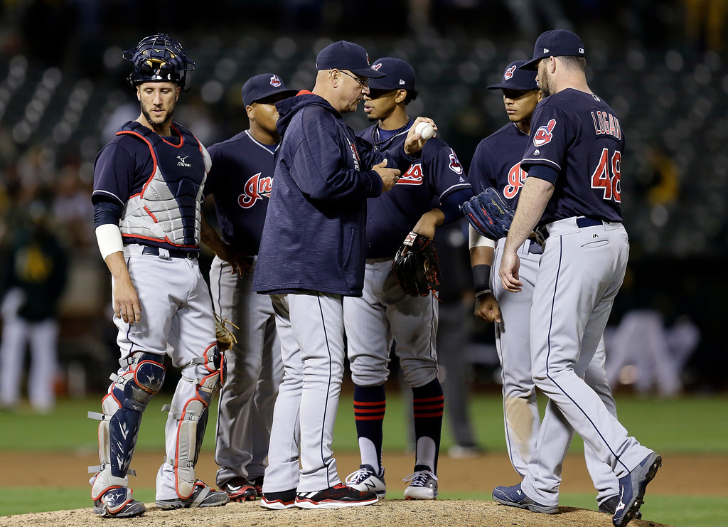 . Cleveland Indians manager Terry Francona, center, hands the ball to pitcher Boone Logan, right, the seventh inning of the team\'s baseball game against the Oakland Athletics on Friday, July 14, 2017, in Oakland, Calif. (AP Photo/Ben Margot)